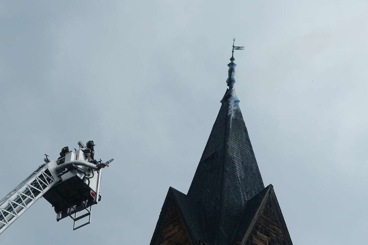 Hour photo/Jeff Dale Norwalk Firefighters respond to a blaze at Little Zion Church after lightning struck the steeple, witnesses say.