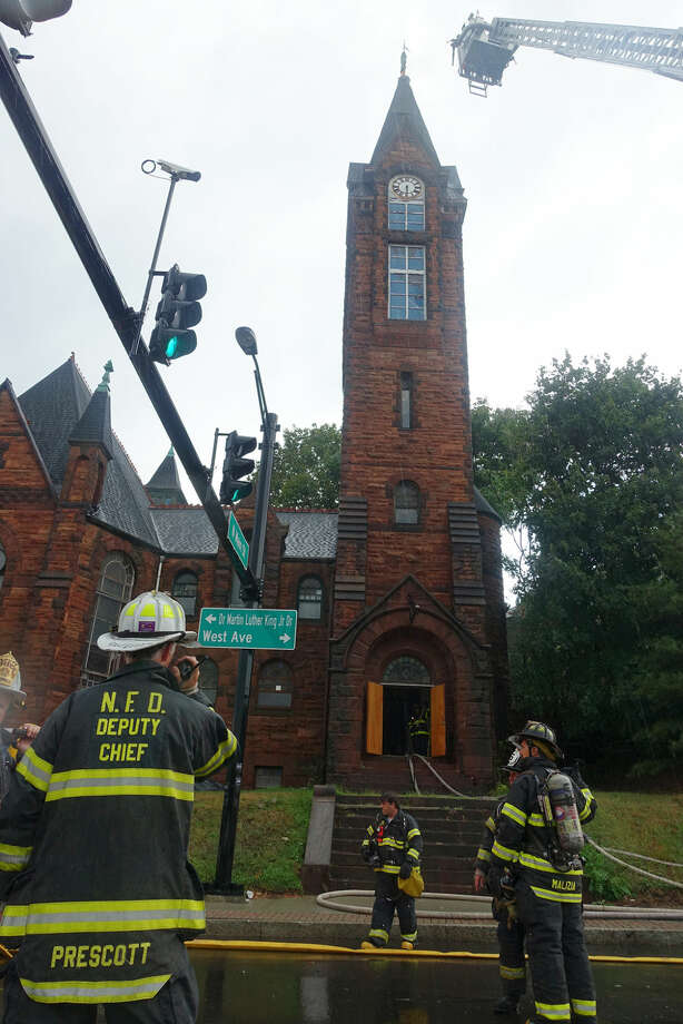 Hour photo/Jeff Dale Norwalk Firefighters respond to this blaze at Little Zion Church after lightning struck the steeple, witnesses say.