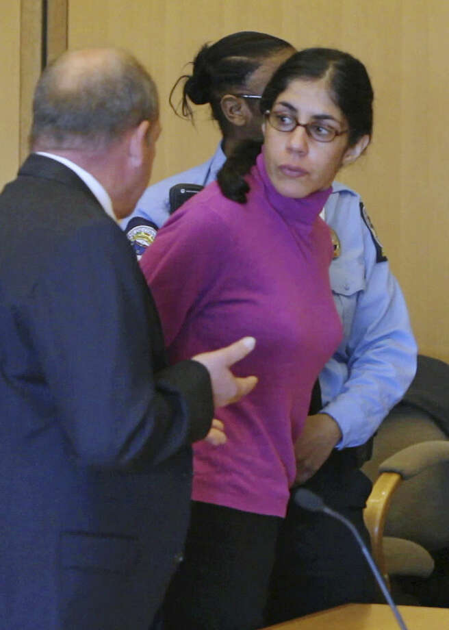 "FILE - In this April 27, 2012 file photo, Sheila Davalloo looks back at Superior Court in Stamford Conn., following her sentencing for the 2002 murder of Anna Lisa Raymundo. Connecticut's Supreme Court is scheduled to hear arguments Wednesday, Oct. 14, 2015, to decide whether there are legal limits to the confidentiality of a conversation between a married couple. Her husband Paul Christos testified during her murder trial that she had frequently told him stories. The state Appellate Court found that the spousal privilege did not apply in this case because Davalloo's conversations with her husband were not ""induced by affection, as required by the law."" ( AP Photo/Matthew Brown, Pool File)"