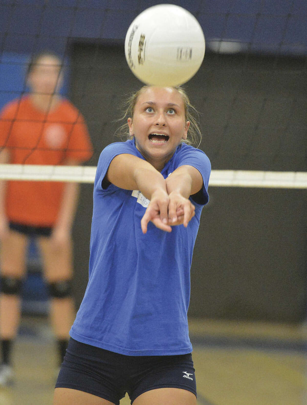 Hour Photo/Alex von Kleydorff Staples vollyball captain Mikaela O'Kelly does a drill at practice last week. O'Kelly is one of a handful of players coach Jon Shepro is going to lean on if the 2014 Wreckers will match their 2013 success.