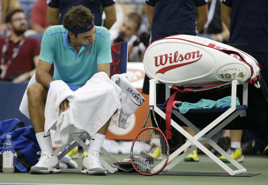 Roger Federer, of Switzerland, takes a break between games against Marin Cilic, of Croatia, during the semifinals of the 2014 U.S. Open tennis tournament, Saturday, Sept. 6, 2014, in New York. (AP Photo/Darron Cummings)