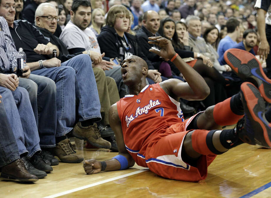 FILE - In this Jan. 30, 2013, file photo, Los Angeles Clippers' Lamar Odom reacts as he falls out of bounds in the second half of an NBA basketball game against the Minnesota Timberwolves in Minneapolis. Odom, the former NBA star and reality TV personality embraced by teammates and fans alike for his humble approach to fame, was hospitalized and his estranged wife Khloe Kardashian is by his side, after being found unresponsive in a Nevada brothel where he had been staying for days. (AP Photo/Jim Mone, File)