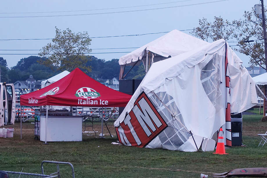 Hour photo/Steve Kobak Rain and wind knocked down tree limbs and tents at the 37th annual Norwalk Oyster Festival Saturday. The Joan Jett concert was canceled and will not be rescheduled.