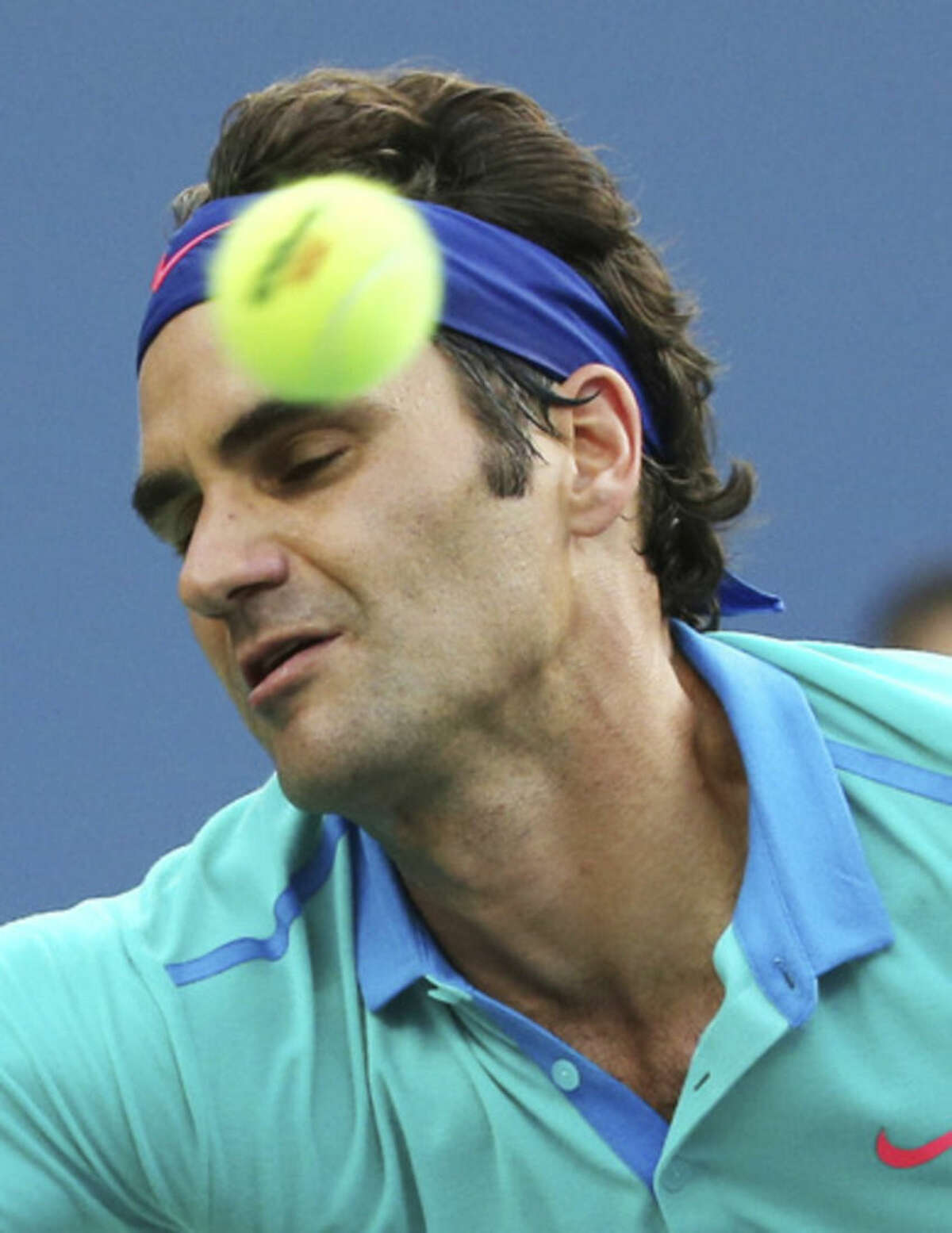 Roger Federer, of Switzerland, returns a shot against Marin Cilic, of Croatia, during the semifinals of the 2014 U.S. Open tennis tournament, Saturday, Sept. 6, 2014, in New York. (AP Photo/Mike Groll)