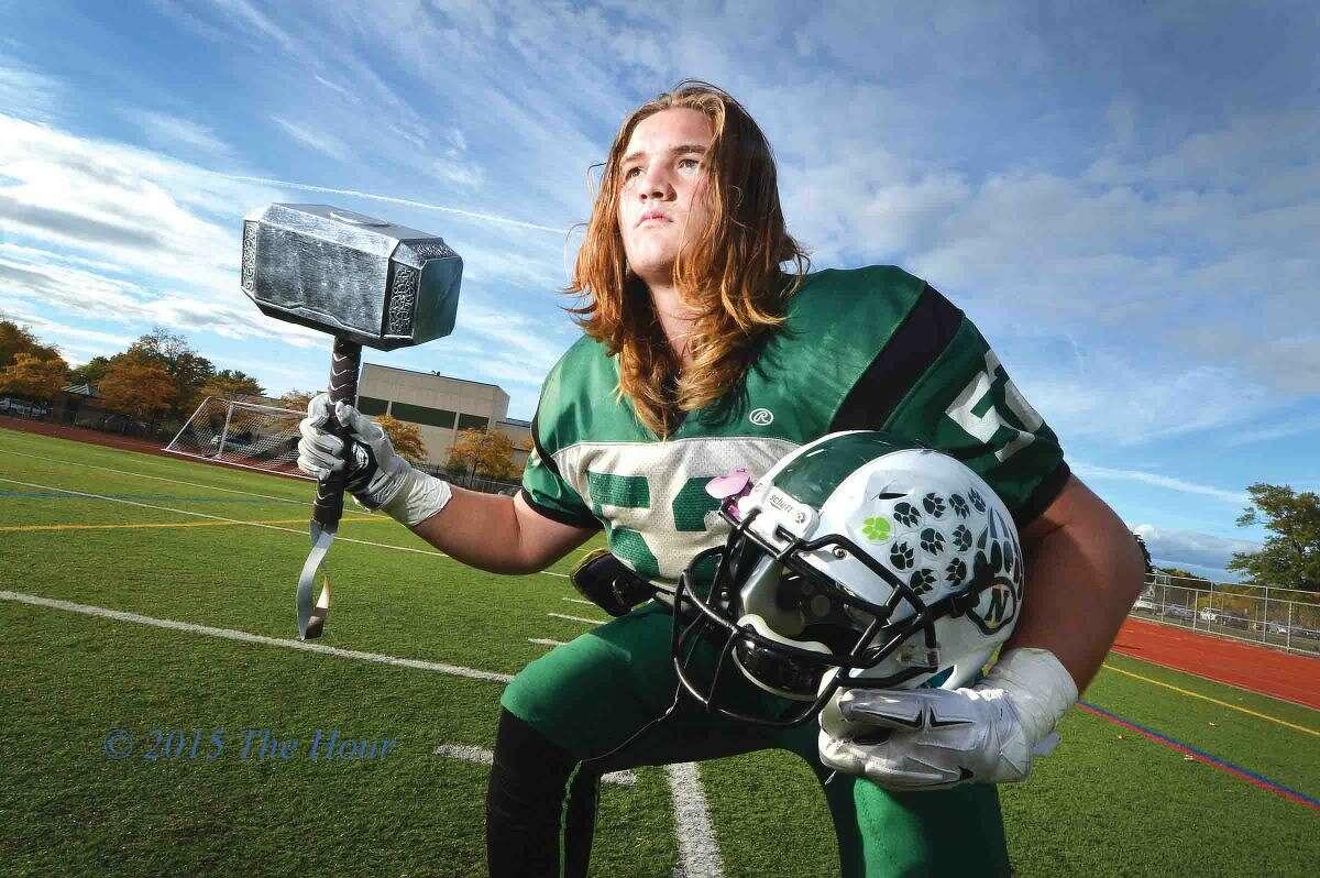 Norwalk's James Makszin poses with Thor's hammer at Testa Field. (Hour photo/Alex von Kleydorff)