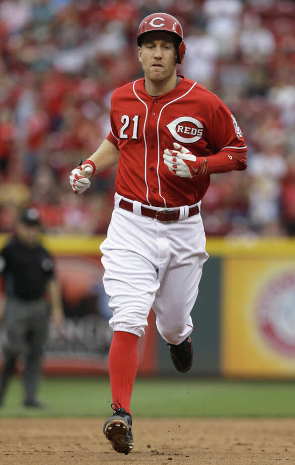 Cincinnati Reds' Todd Frazier rounds the bases after hitting a solo home run off New York Mets starting pitcher Dillon Gee in the sixth inning of a baseball game, Saturday, Sept. 6, 2014, in Cincinnati. (AP Photo/Al Behrman)