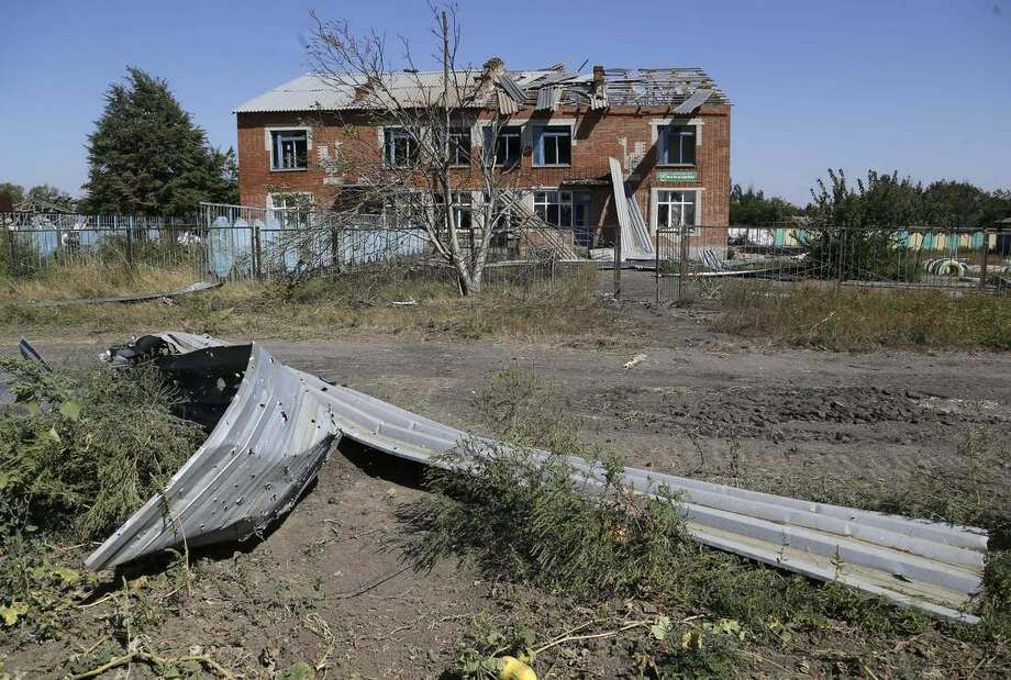 A destroyed kindergarten building is seen in the village of Kominternove , Ukraine, Saturday, Sept. 6, 2014. After four months of war, eastern Ukraine begins the first full day of an uncertain cease-fire. The truce agreement calls for an exchange of prisoners and establishment of humanitarian corridors, but how quickly those actions will begin is unclear. (AP Photo/Sergei Grits)