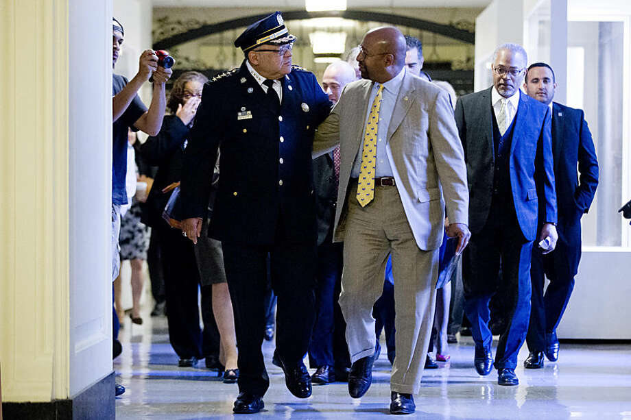 Philadelphia Police Commissioner Charles Ramsey, left, and Philadelphia Mayor Michael Nutter walk to a news conference Wednesday, Oct. 14, 2015, at City Hall in Philadelphia. Ramsey announced his retirement Wednesday at a news conference as the administration that brought him to the city comes to an end. His last day will be Jan. 7. (AP Photo/Matt Rourke)