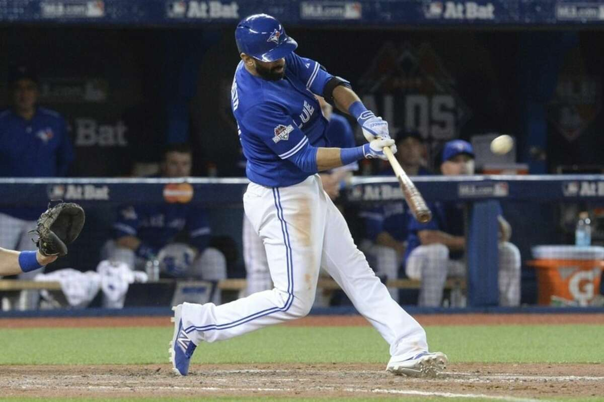 Toronto Blue Jays Jose Bautista hits a three-run home run during the seventh inning in Game 5 of baseball's American League Division Series, Wednesday, Oct. 14, 2015 in Toronto. The Toronto Blues Jays beat the Texas Rangers 6-3. (Chris Young/The Canadian Press via AP) MANDATORY CREDIT