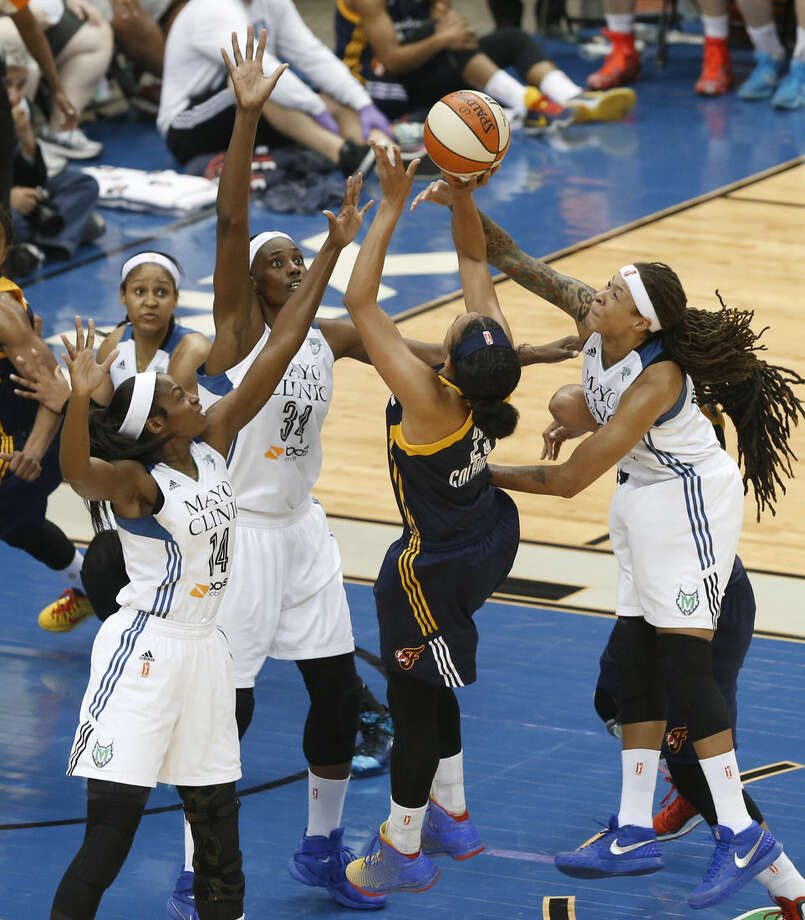 Indiana Fever guard Marissa Coleman (25) shoots as Minnesota Lynx forward Devereaux Peters (14), center Sylvia Fowles (34) and Seimone Augustus (33) defend in the first half of Game 5 of the WNBA basketball finals, Wednesday, Oct. 14, 2015, in Minneapolis. (AP Photo/Stacy Bengs)