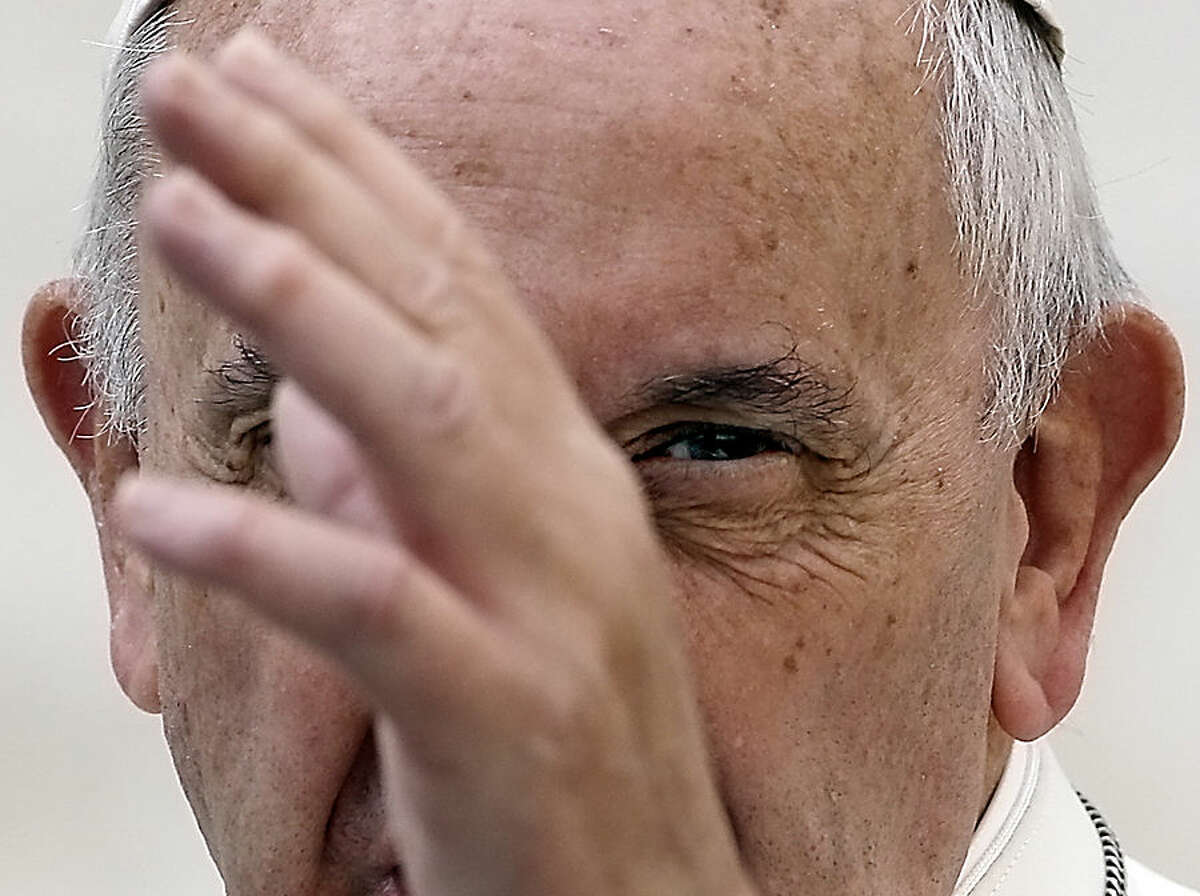 Pope Francis delivers his blessing as he arrives in St. Peter's Square for the weekly general audience, at the Vatican, Wednesday, Oct. 14, 2015. (AP Photo/Gregorio Borgia)
