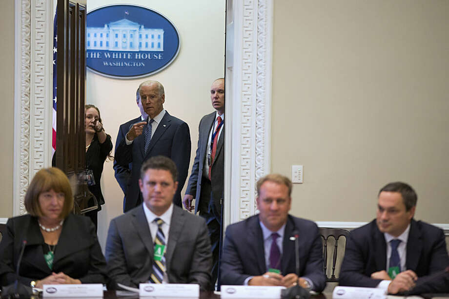 Vice President Joe Biden arrives for the White House Build America Investment Initiative roundtable, Wednesday, Oct. 14, 2015, in the Eisenhower Executive Office Building on the White House complex in Washington. (AP Photo/Evan Vucci)