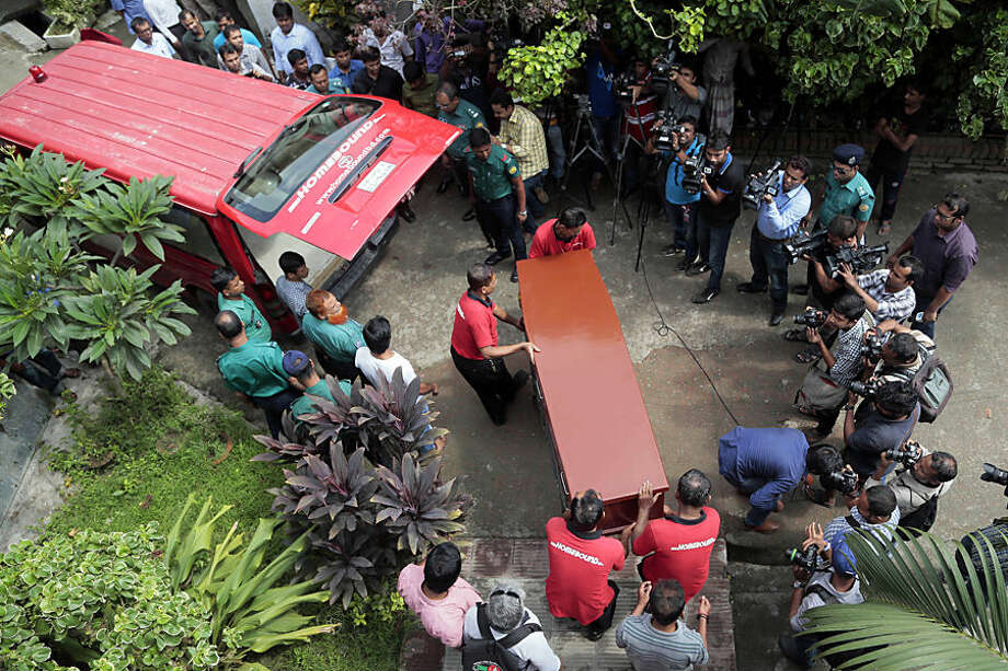 The body of Italian citizen Cesare Tavella, who was gunned down by unidentified assailants, is carried towards a waiting ambulance in Dhaka, Bangladesh, Wednesday, Oct. 14, 2015. The recent killings of two foreigners in the country, Tavella and a Japanese, has spooked tourists and expatriates in the impoverished South Asian nation, raising alarms about whether Islamic radicals are gaining a foothold and whether foreigners are safe in the moderate, secular nation. (AP Photo/A.M. Ahad)