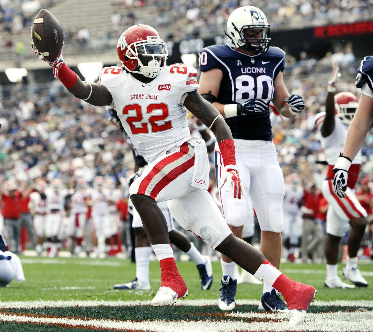 Stony Brook defensive back Naim Cheeseboro (22) celebrates after a Connecticut fumble for a touchdown during the first half of an NCAA college football game at Rentschler Field, Saturday, Sept. 6, 2014, in East Hartford, Conn. (AP Photo/Jessica Hill)