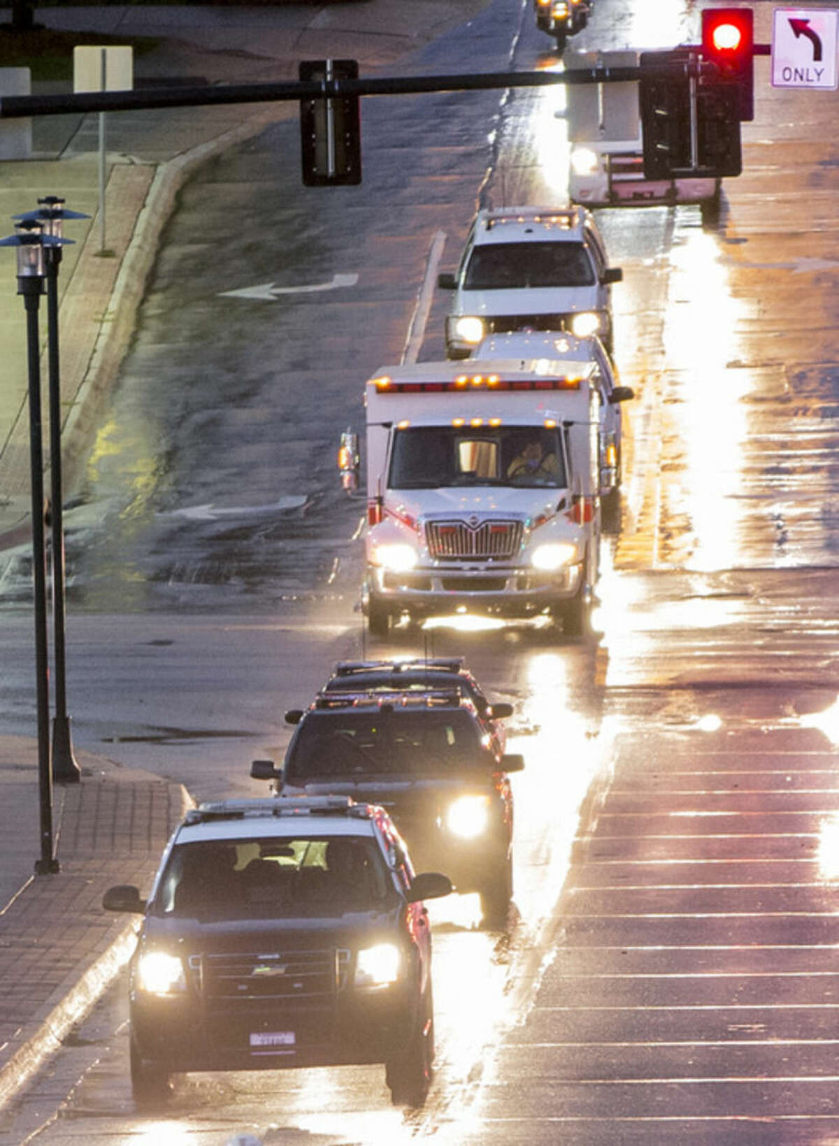 The ambulance transporting Dr. Rick Sacra, 51, who was infected with Ebola while serving as an obstetrician in Liberia, arrives escorted by police vehicles to the Nebraska Medical Center in Omaha, Neb., Friday, Sept. 5, 2014. Sacra, who served with North Carolina-based charity SIM, is the third American aid worker infected by the Ebola virus. He will begin treatment in the hospital's 10-bed special isolation unit, the largest of four such units in the U.S. (AP Photo/Nati Harnik)