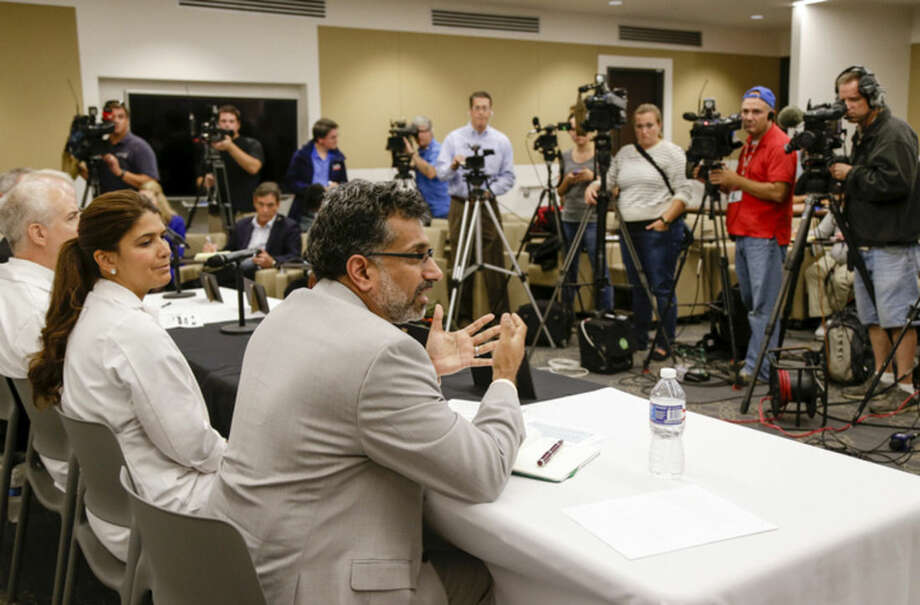 Ali S. Khan, dean of the Nebraska Medical Center College of Public Health, center, with Rosanna Morris, Chief Operating Officer of the Nebraska Medical Center, second from left, speaks at a news conference in Omaha, Neb., Friday Sept. 5, 2014, on the condition of ebola patient Dr. Rick Sacra, 51, who is being treated at the Nebraska Medical Center in Omaha. Sacra, who served with North Carolina-based charity SIM, is the third American aid worker infected by the Ebola virus. He will begin treatment in the hospital's 10-bed special isolation unit, the largest of four such units in the U.S. (AP Photo/Nati Harnik)