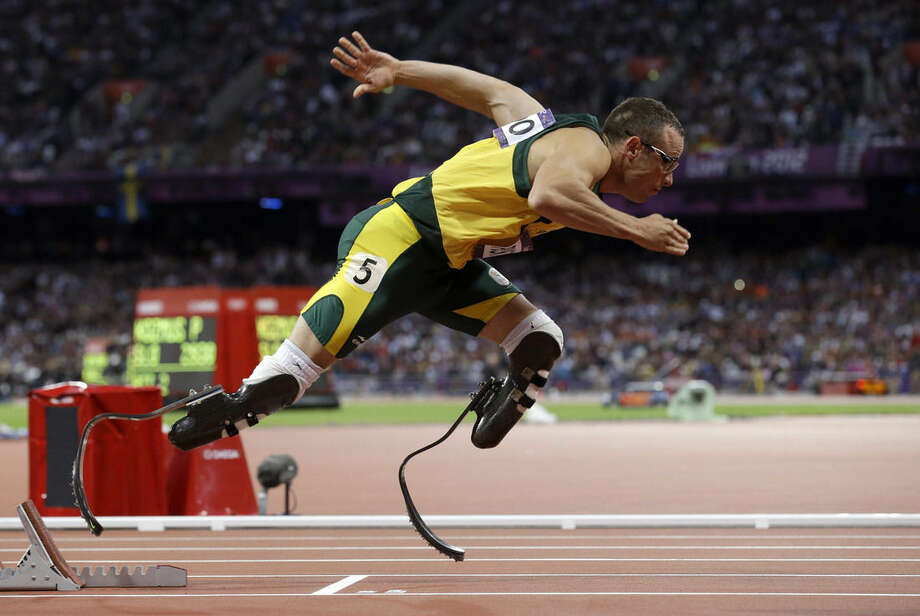 FILE - In this Sunday, Aug. 5, 2014 file photo South Africa's Oscar Pistorius starts in the men's 400-meter semifinal during the athletics in the Olympic Stadium at the 2012 Summer Olympics, London. Pistorius is expected to be released from jail on Tuesday, Oct. 20, 2015 under house arrest. (AP Photo/Anja Niedringhaus, File)