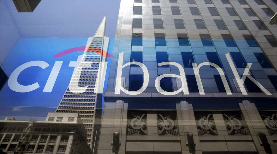 In this July 9, 2014, photo, the Transamerica Pyramid is reflected in the window of the main branch of Citibank in the Financial District of San Francisco. Citigroup reports quarterly financial results Thursday, Oct. 15, 2015. (AP Photo/Eric Risberg)