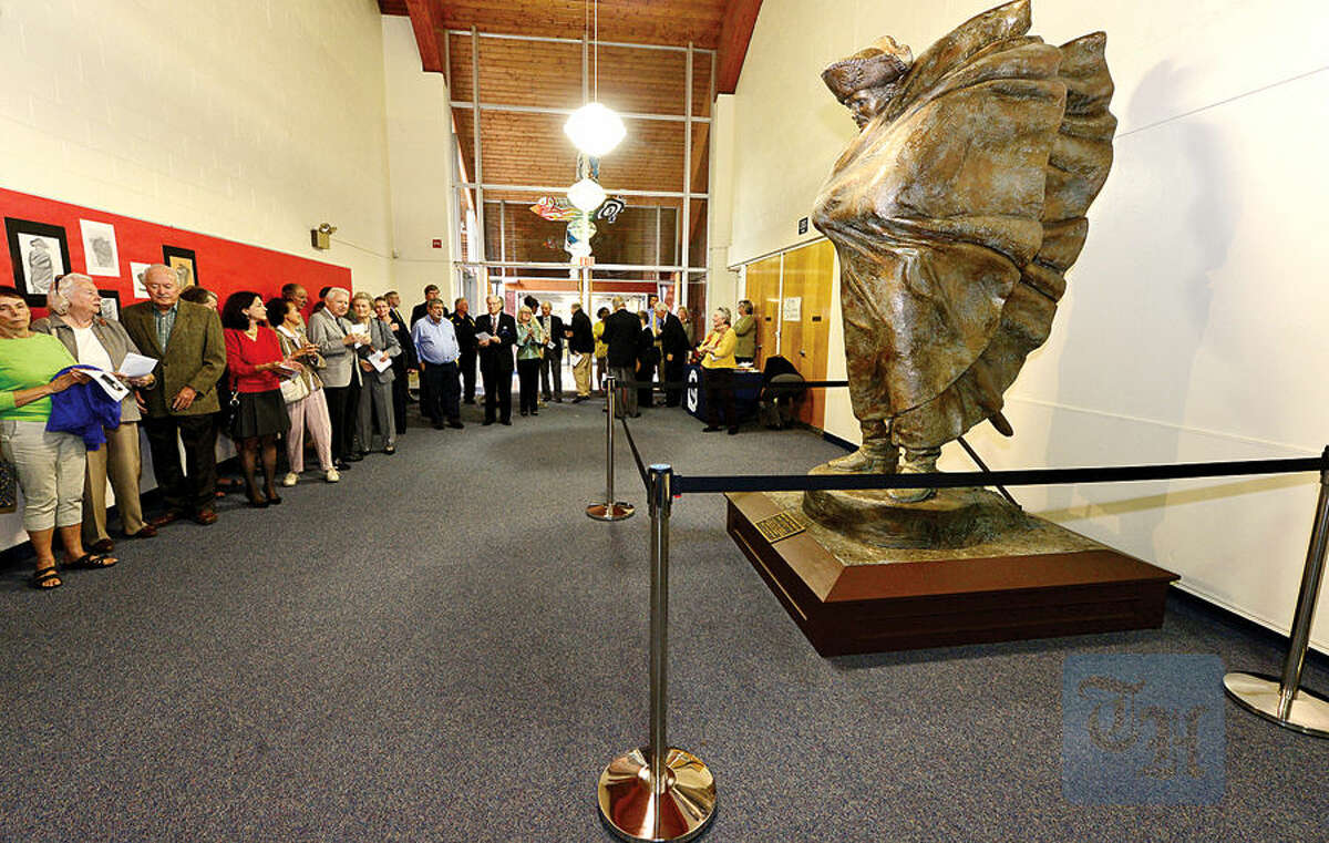 Hour photo / Erik Trautmann The 8 ft.statue, Valley Forge Washington, by Wilton resident Gifford Proctor, is dedicated during a ceremony at it's new home in Middlebrook Middle School Tuesday.