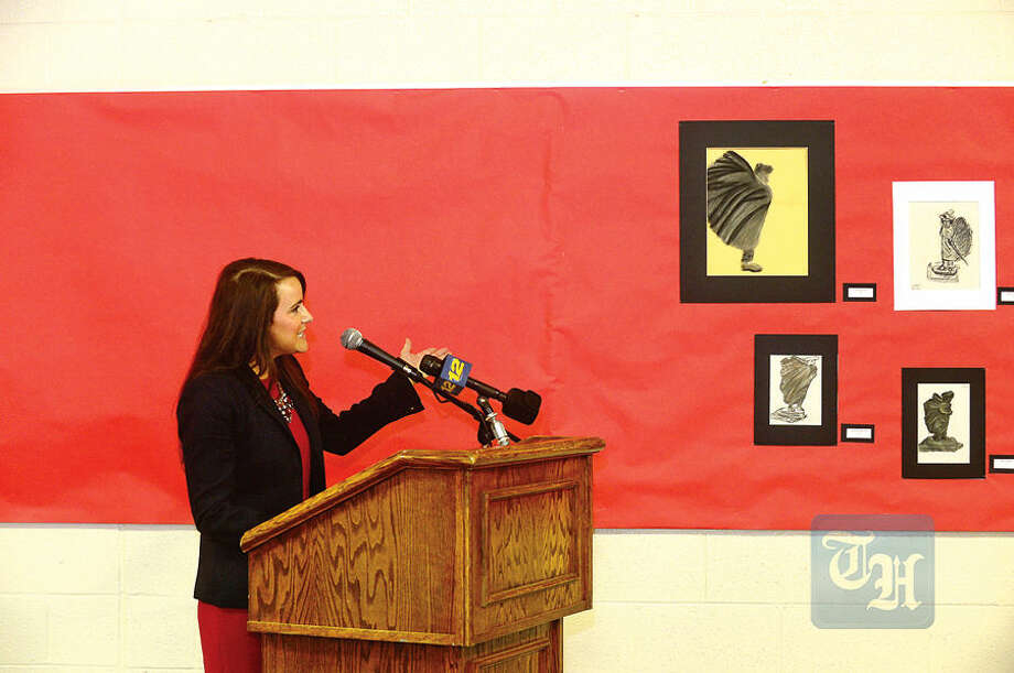 Hour photo / Erik Trautmann Middlebrook Middle School principal, Maria Coleman, speaks during the dedication ceremony for the 8 ft. statue, Valley Forge Washington, by Wilton resident Gifford Proctor in it's permanent home in Middlebrook Middle School Tuesday.