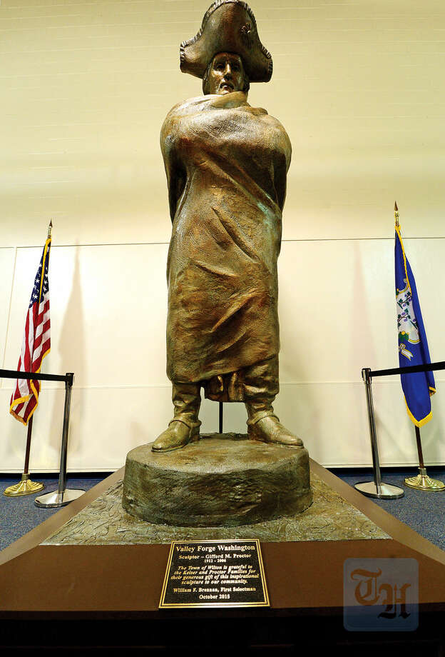 Hour photo / Erik Trautmann The 8 ft. statue, Valley Forge George, by Wilton resident Giffrod Proctor, is dedicated during a ceremony at its new home in Middelbrook Middle School Tuesday.