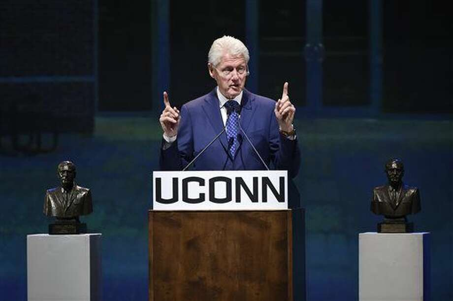 Former President Bill Clinton gives the keynote address on the University of Connecticut's Storrs campus after receiving the Thomas J. Dodd Prize in International Justice and Human Rights, Thursday, Oct. 15, 2015. (Cloe Poisson/Hartford Courant via AP) MANDATORY CREDIT