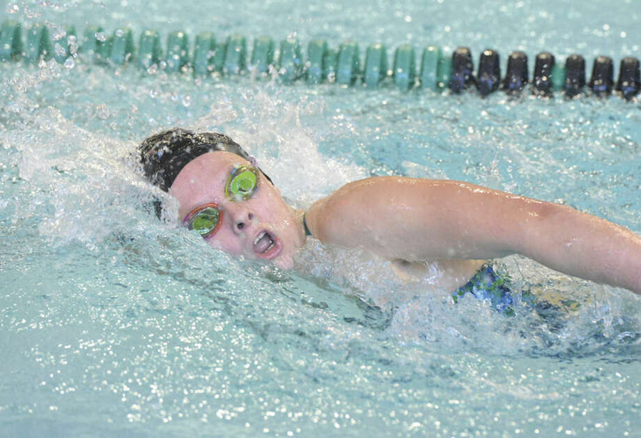 Hour Photo/Alex von KleydorffNorwalk-McMahon's Hayley Linder swims during the 200 free which she won against St. Joseph on Thursday.