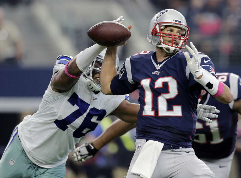 New England Patriots' Tom Brady (12) is pressured by Dallas Cowboys' Greg Hardy (76) during the first quarter of an NFL football game, Sunday, Oct. 11, 2015, in Arlington, Texas. (AP Photo/Tim Sharp)