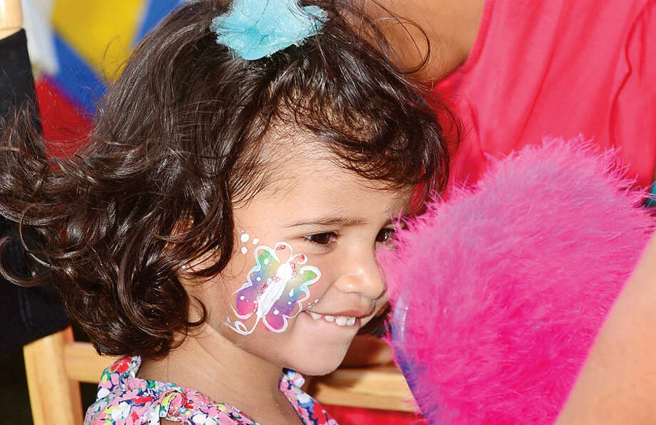 Hour photo / Erik Trautmann Valentina Sanchez, 2, gets her face painted at the Norwalk Seaport Association's 37th annual Oyster Festival at Veteran's Park Saturday.