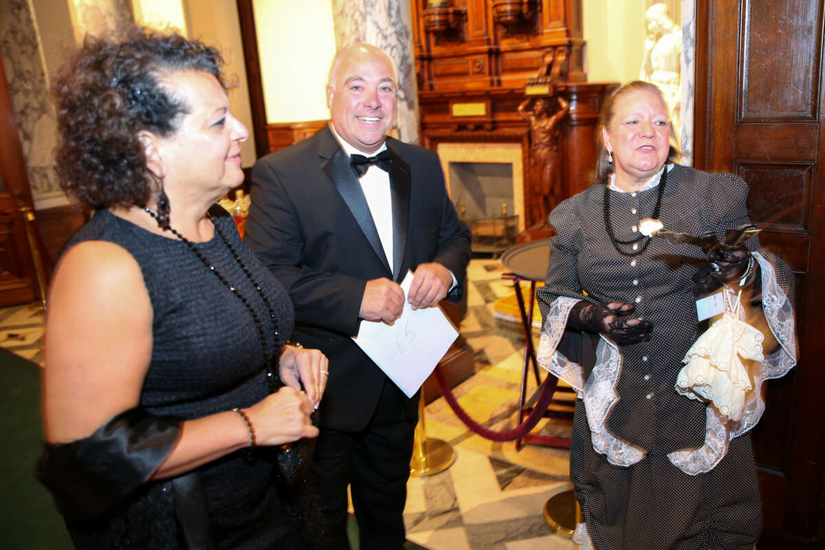 Hour photo/Chris Palermo Rose Carroll, impersonating Mrs. Mathews, greets guests at the Lockwood Mathews Mansion Gala Saturday night.