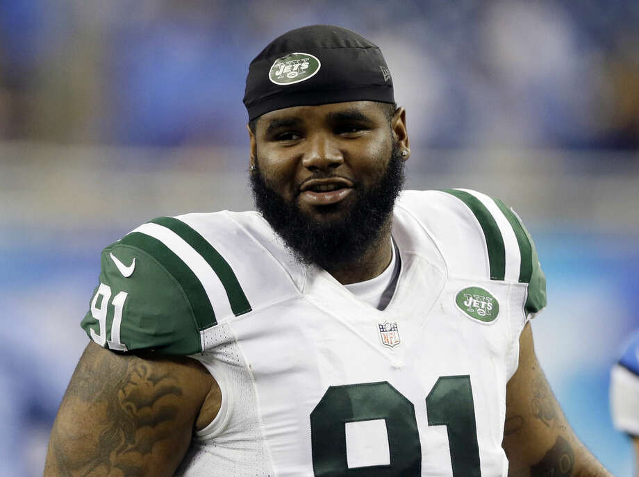 FILE - In this Aug. 13, 2015, file photo, New York Jets defensive end Sheldon Richardson walks off the field following an NFL preseason football game against the Detroit Lions in Detroit. A lapse in judgment cost Richardson the first four games of the season, the result of an NFL-issued suspension for violating the league's substance abuse policy. (AP Photo/Duane Burleson, File)