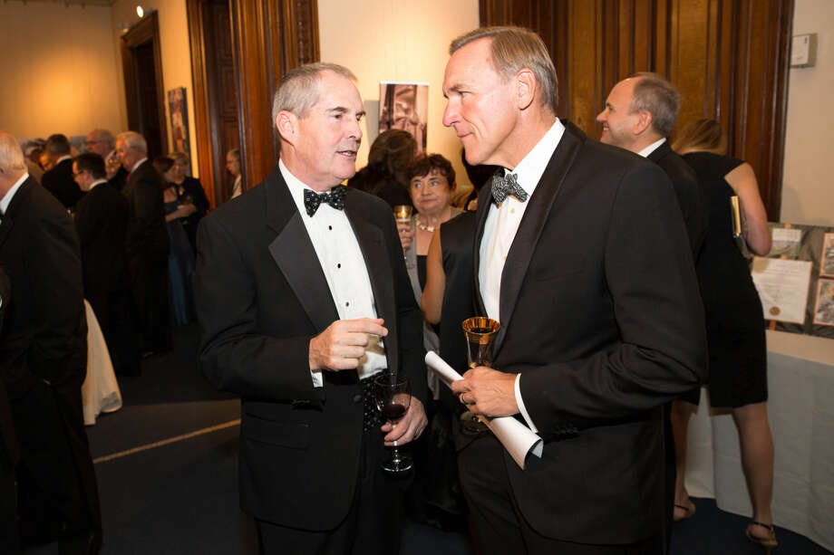 Hour photo/Chris Palermo Stan Galanski and Tom Slattery converse at the Lockwood Mathews Mansion Gala Saturday night.