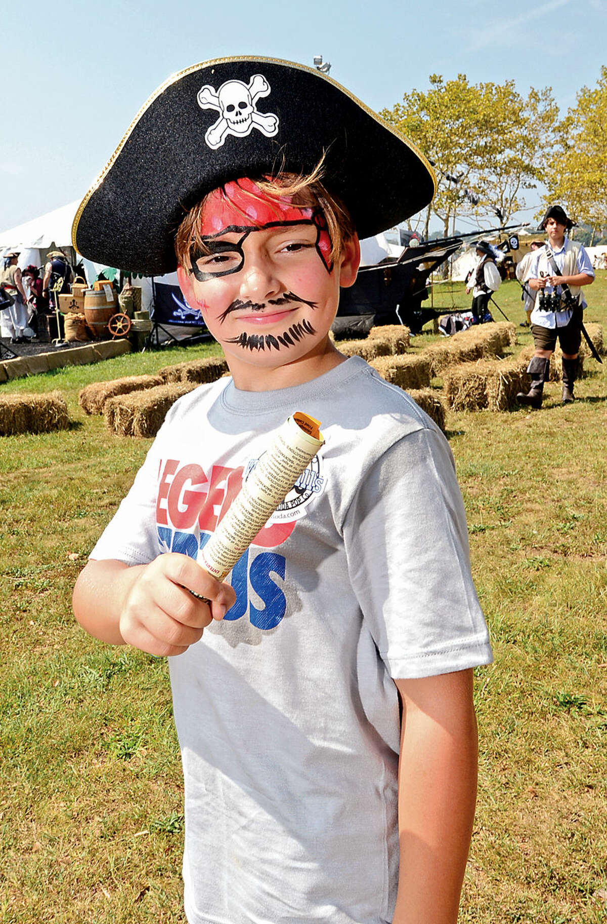 Hour photo / Erik Trautmann Gabe Cromley, 7, dresses up as a pirate for the Norwalk Seaport Association's 37th annual Oyster Festival at Veteran's Park Saturday.