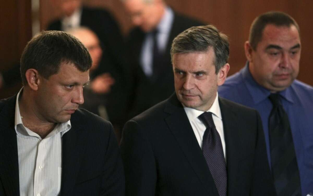 From left, Alexander Zakharchenko, the leader of pro-Russian rebels in Donetsk, Russian Ambassador to Ukraine Mikhail Zurabov and Igor Plotnitsky, the leader of pro-Russian rebels in the Luhansk region, meet with the media after talks on cease-fire in Ukraine in Minsk, Belarus, Friday, Sept. 5, 2014. The Ukrainian president declared a cease-fire Friday to end nearly five months of fighting in the nation's east after his representatives reached a deal with the Russian-backed rebels at peace talks in Minsk. (AP Photo)