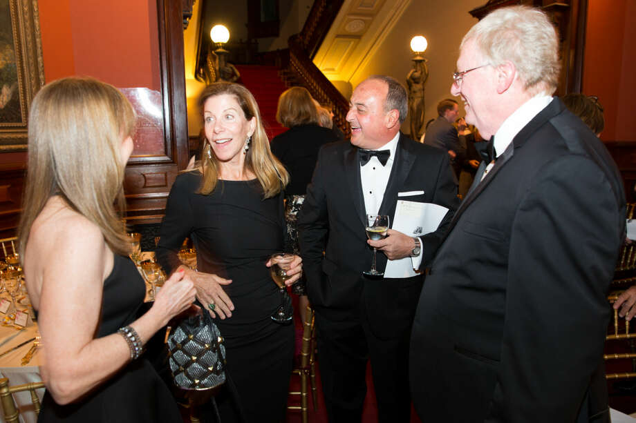 Hour photo/Chris Palermo Chris Bradley and Larry Cafero mingle with guests at the Lockwood Mathews Mansion Gala Saturday night. at the Lockwood Mathews Mansion Gala Saturday night.