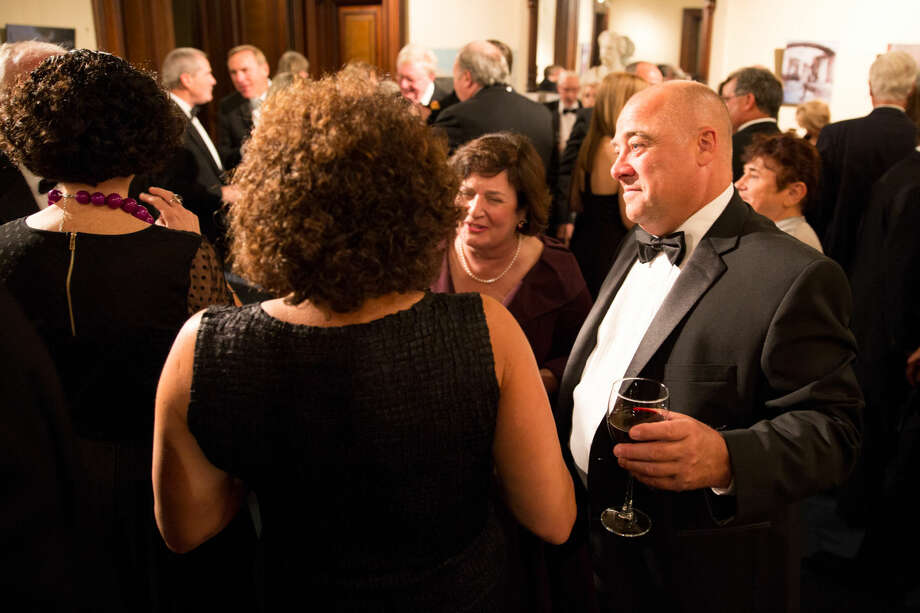 Hour photo/Chris Palermo Guests mingle at the silent auction at the Lockwood Mathews Mansion Gala Saturday night.