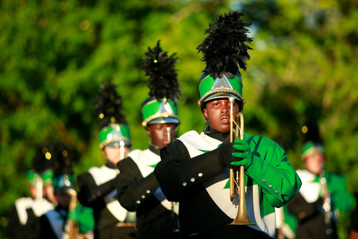 """Hour photo/Chris Palermo. The Norwalk High School Marching Bears perform a part of their 2015-2016 field show """"The Cry of Valkerie"""" at Andrew's Field Friday evening."""