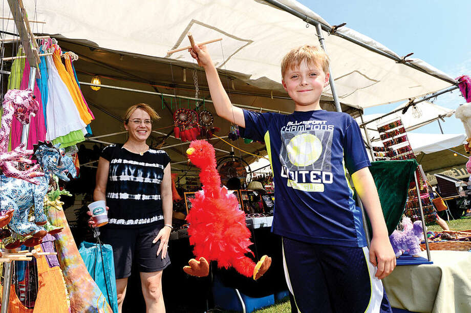 Hour photo / Erik Trautmann Trevor Bowls, 9, finds a puppet at the craft tents during the Norwalk Seaport Association's 37th annual Oyster Festival at Veteran's Park Saturday.
