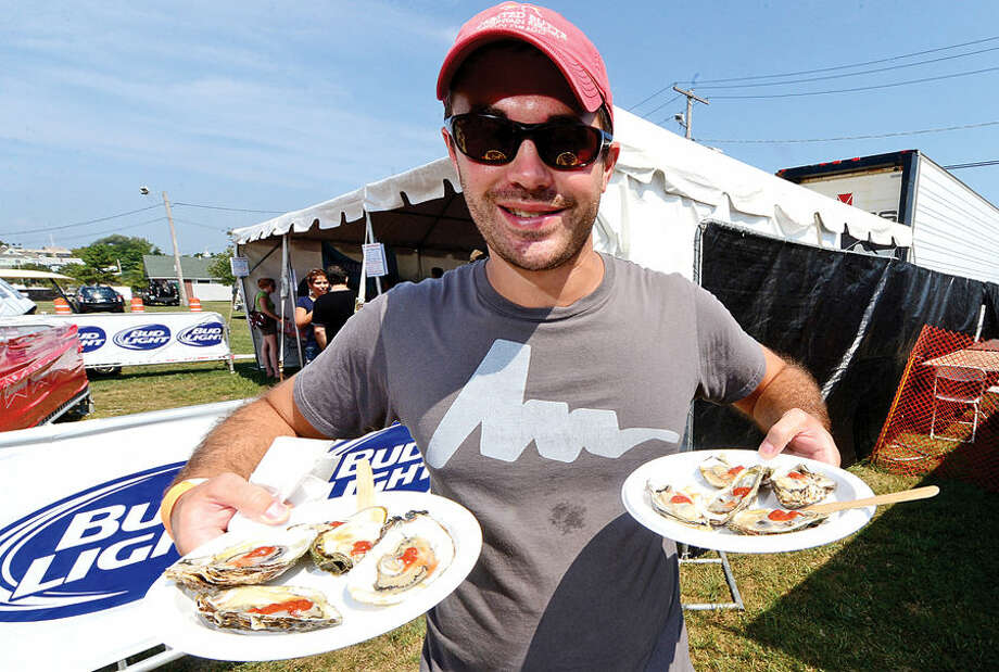 Hour photo / Erik Trautmann Louis Schede gets ready to chow down on some oysters during the Norwalk Seaport Association's 37th annual Oyster Festival at Veteran's Park Saturday.