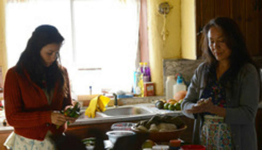 "This photo released by courtesy of Magnolia Pictures shows Eva Longoria, left, and Monica Sanchez in a scene from the film, ""Frontera,"" a Magnolia Pictures release. (AP Photo/Courtesy Magnolia Pictures)"