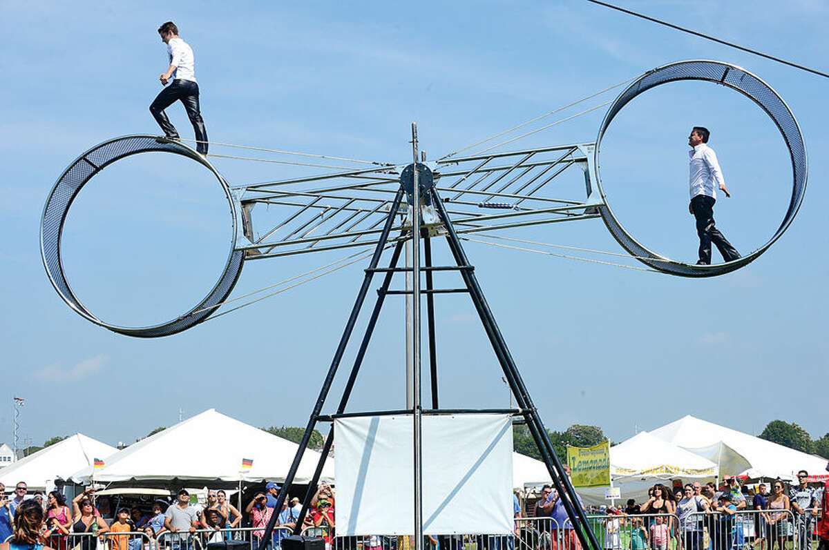 Hour photo / Erik Trautmann Members of Nerveless Nocks Mortorcycle Show perform during the Norwalk Seaport Association's 37th annual Oyster Festival at Veteran's Park Saturday.