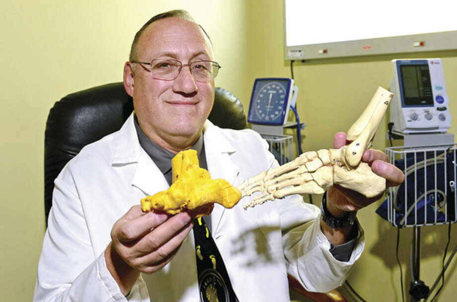 Hour photo / Erik TrautmannDr. F. Scott Gray used a 3D-printed model of a patient's foot to help him perform a complicated surgery.