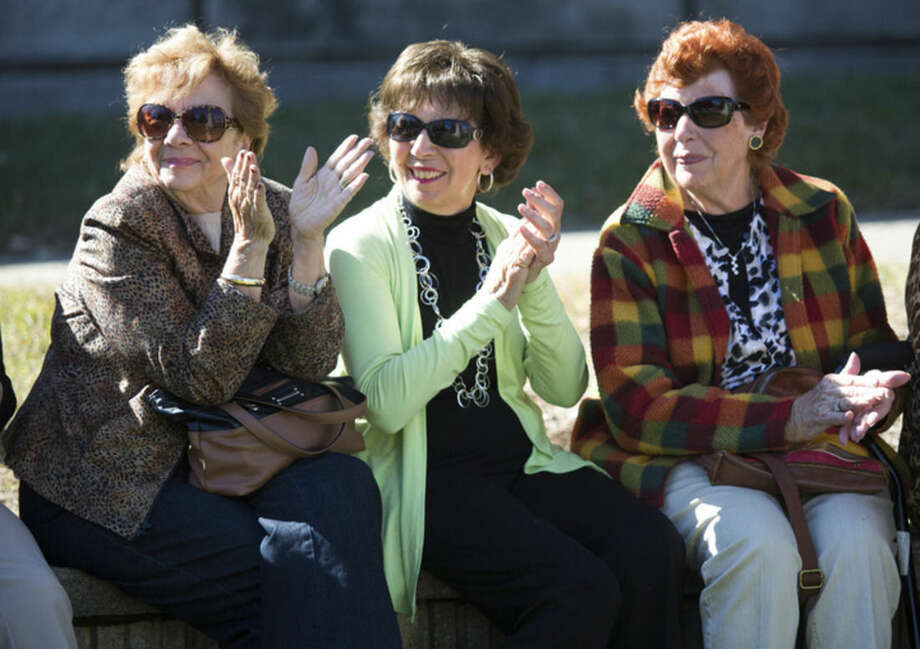 Hour photo/Chris PalermoMarie Wilmont, Grace Smith and Ellen Morrone applaud at the Italian-American Day commemoration at Heritage Wall in Norwalk Sunday.