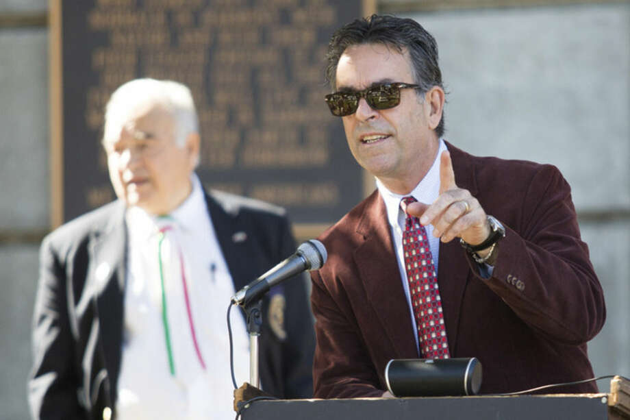 Hour photo/Chris PalermoPat Catrone, chairman of the St. Ann Club board of directors, speaks at the Italian American Day commemoration at Heritage Wall in Norwalk Sunday.