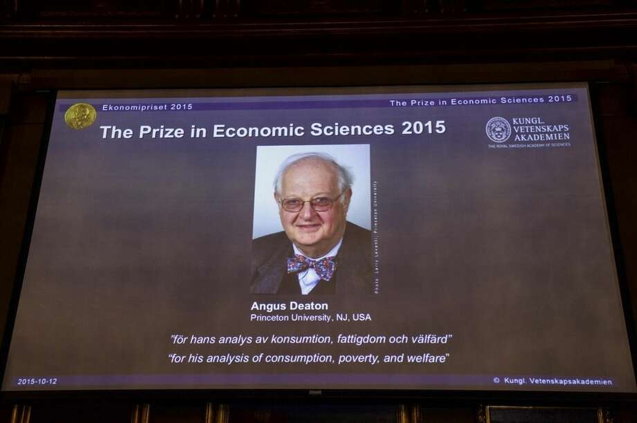 "A view of the screen showing an image of Professor Angus Deaton, winner of the 2015 Sveriges Riksbank Prize in Economic Sciences in Memory of Alfred Nobel, as the Permanent Secretary for the Royal Swedish Academy of Sciences addresses a press conference to announce the winner of the prize, at the Royal Swedish Academy of Science, in Stockholm, Sweden, Monday, Oct. 12, 2015. Scottish economist Angus Deaton has won the Nobel memorial prize in economic sciences for ""his analysis of consumption, poverty, and welfare,"" the Royal Swedish Academy of Sciences said Monday. (Maja Suslin/TT News Agency via AP)"