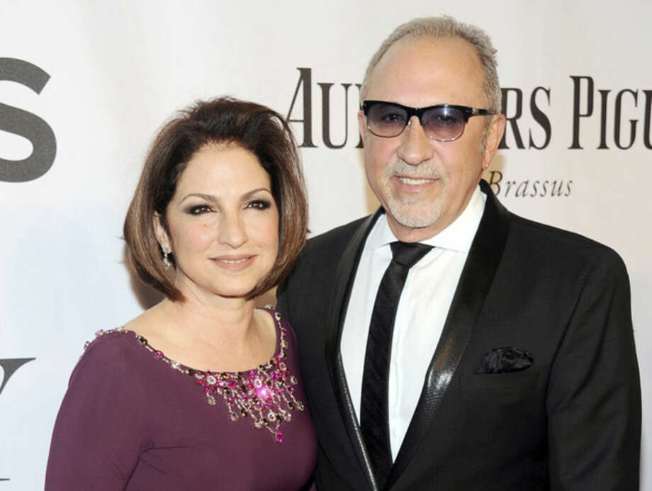 """FILE - In this June 8, 2014, file photo, Gloria Estefan, left, and Emilio Estefan pose for photos at the 68th annual Tony Awards at Radio City Music Hall in New York. Gloria Estefan and her husband, Emilio, are shepherding their musical biography """"On Your Feet!"""" to Broadway this fall, celebrating two Cuban-Americans who embraced the American Dream and now own enough Grammy Awards to fill a house. (Photo by Charles Sykes/Invision/AP, File)"""