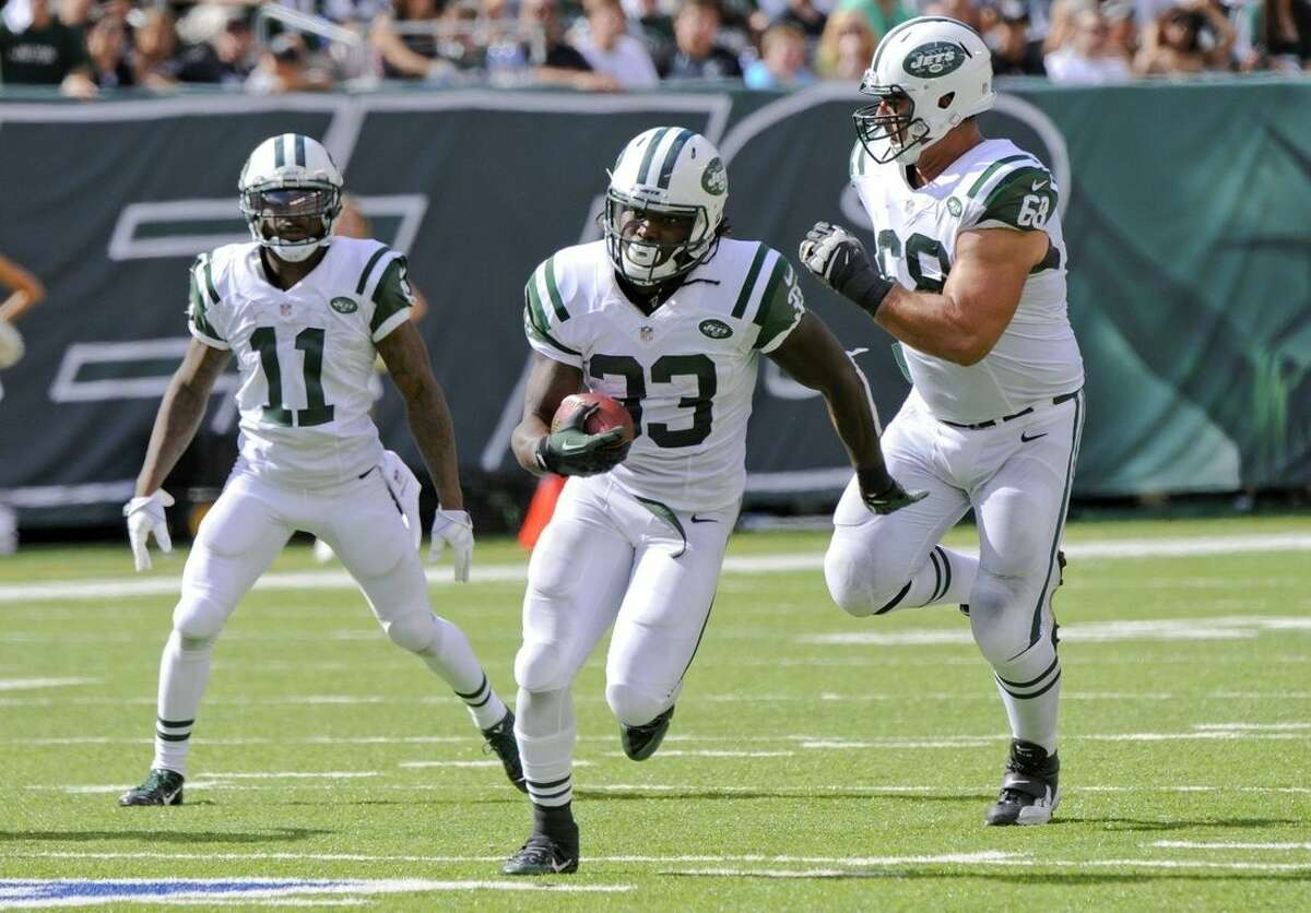 New York Jets running back Chris Ivory (33) rushes for a touchdown during the second half of an NFL football game against the Oakland Raiders Sunday, Sept. 7, 2014, in East Rutherford, N.J. (AP Photo/Bill Kostroun)