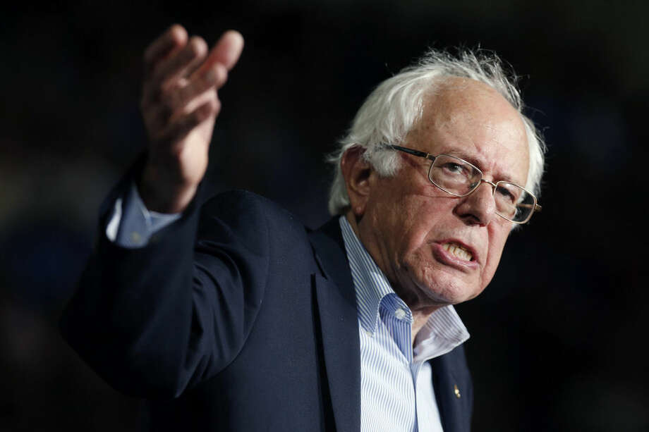 """In this photo taken Oct. 3, 2015, Democratic presidential candidate, Sen. Bernie Sanders, I-Vt, speaks during a campaign rally in Springfield, Mass. Hillary Rodham Clinton says she always expected tough competition in the Democratic presidential primary. She likely didn't expect it would come from Sanders, the rumpled independent senator from Vermont and a self-described democratic socialist calling for """"political revolution."""" (AP Photo/Michael Dwyer)"""