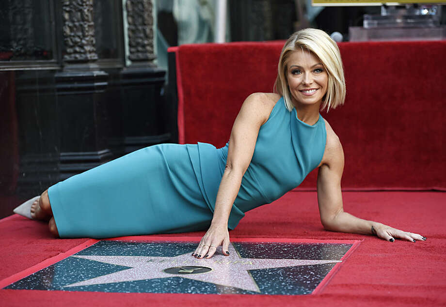 Television personality Kelly Ripa poses next to her new star on the Hollywood Walk of Fame on Monday, Oct. 12, 2015, in Los Angeles. (Photo by Chris Pizzello/Invision/AP)