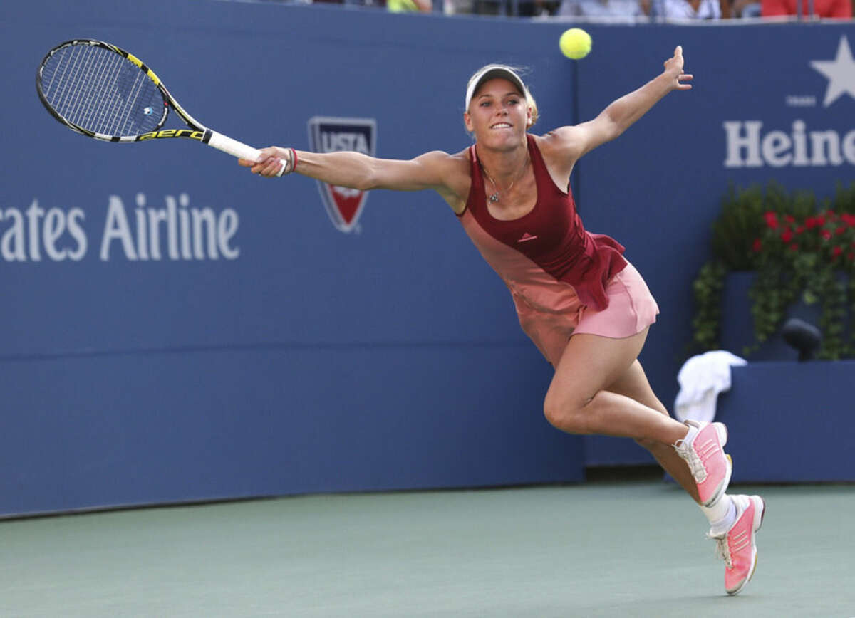 Caroline Wozniacki, of Denmark, returns a shot against Serena Williams during the championship match of the 2014 U.S. Open tennis tournament, Sunday, Sept. 7, 2014, in New York. (AP Photo/Mike Groll)